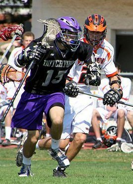 Nick Condon, Junior Middie, clears against Catholic
