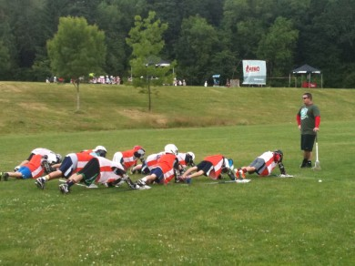 Coach Tillson holding the youngsters accountable with some push-ups.