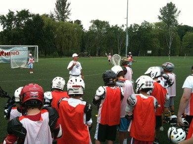 Coach V challenging the campers to hustle.