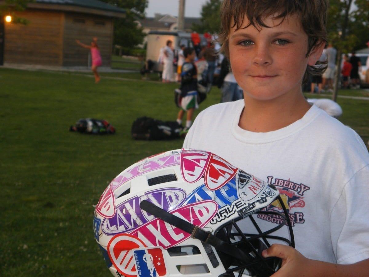 LAS stickers at lacrosse camp helmet collage