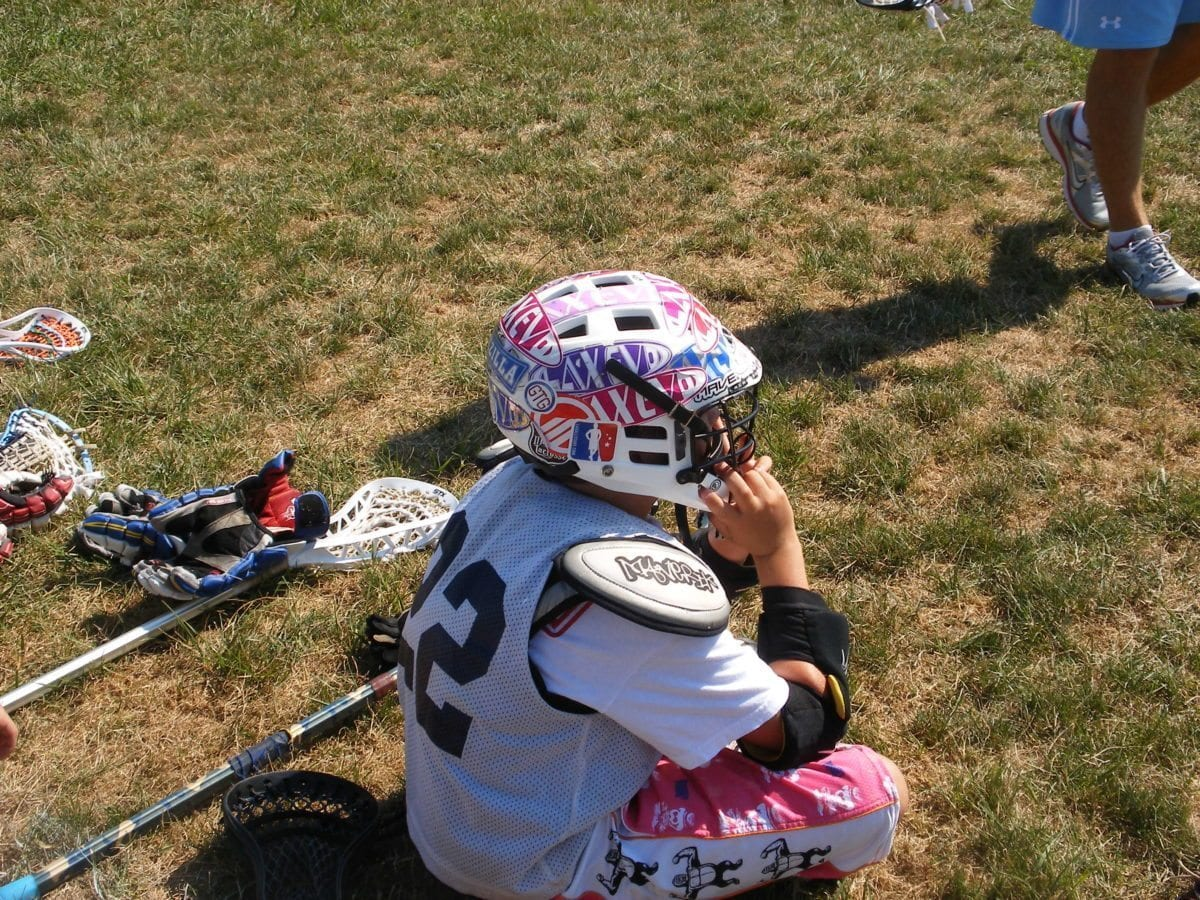 Marty and his sick LacEvo/LAS custom helmet wrap listening intently to coach Garzia.