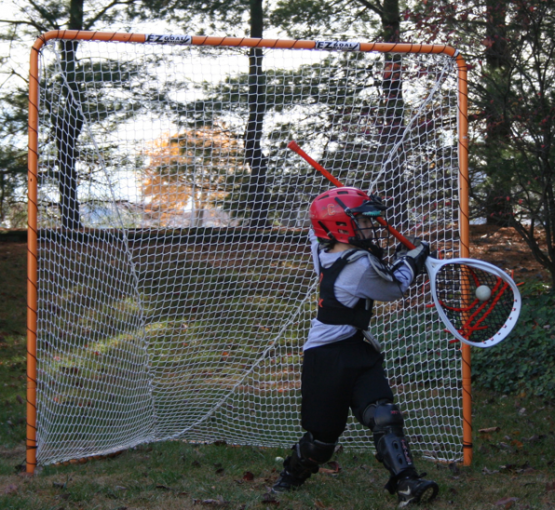 10 year old Maximus lacrosse goalie off hip save