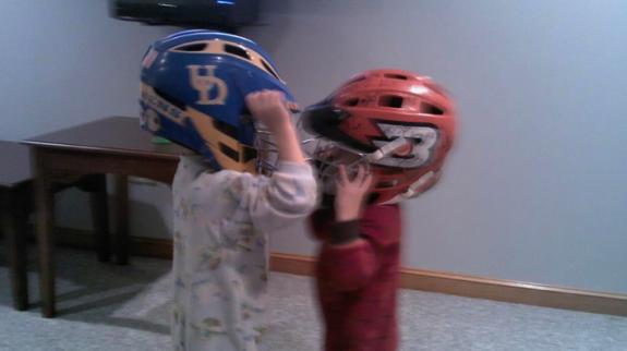 kids lacrosse helmet fight wrestle brothers
