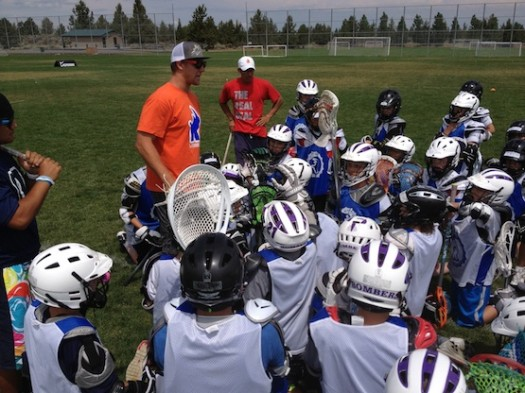 Coach G wrapping up the day with the young guns.