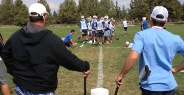 Coach Cost and Coach Mikey officiating the WORLD FAMOUS RHINO LACROSSE CAMP BUCKET TOSS CHALLENGE. Yes, World Famous.