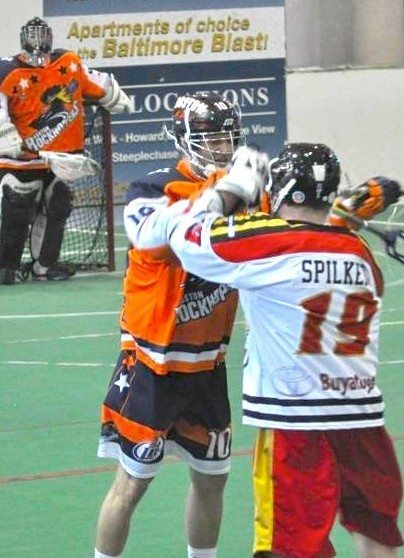 Malcolm Chase and Devan Spilker mix it up. Penalties killed Baltimore.