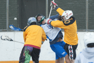 NYC Box Lacrosse - Drew Geiger gets hit - Photo Credit: Bill Schick