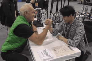 Billy arm wrestling sceptre7 giveaway at #LaxCon Us lacrosse convention in Philadelphia, PA