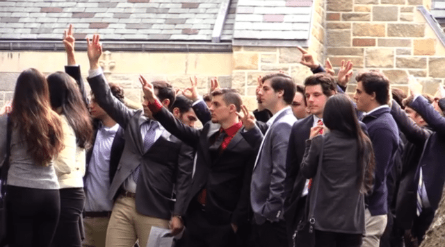 Robby's teammates raising threes outside the funeral