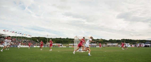 Canada's Emily Boissonneault chases the USA's Brooke Griffin at the 2017 FIL Rathbones Women's Lacrosse World Cup at Surrey Sports Park, Guilford, Surrey, UK, 15th July 2017