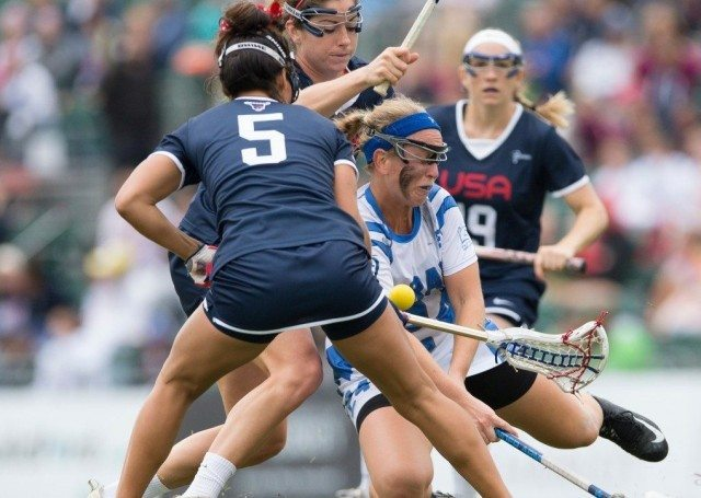Israel's Sarah Meisenberg goes down under intense pressure from the USA offence at the 2017 FIL Rathbones Women's Lacrosse World Cup, at Surrey Sports Park, Guildford, Surrey, UK, 19th July 2017.