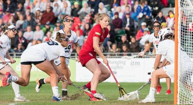 USA GK, Devon Wills saves from England's Camilla Hayes at the 2017 FIL Rathbones Women's Lacrosse World Cup at Surrey Sports Park, Guilford, Surrey, UK, 15th July 2017