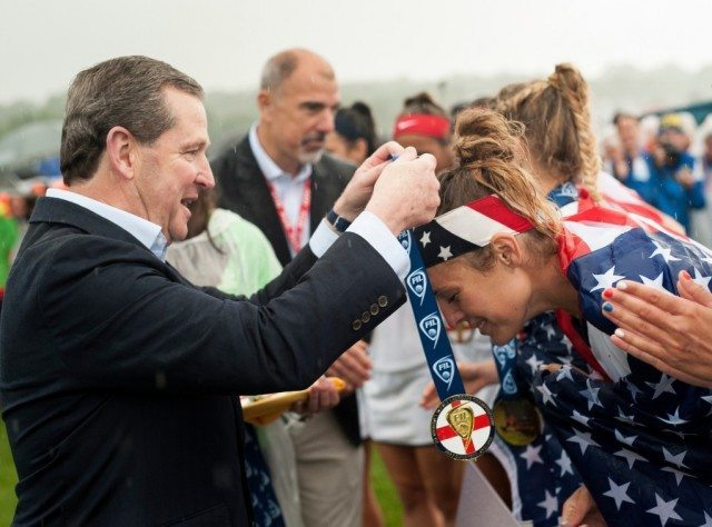 Rathbones Philip Howell presents the medals to the USA 2017 FIL Rathbones Women's Lacrosse World Cup, at Surrey Sports Park, Guildford, Surrey, UK, 22nd July 2017.