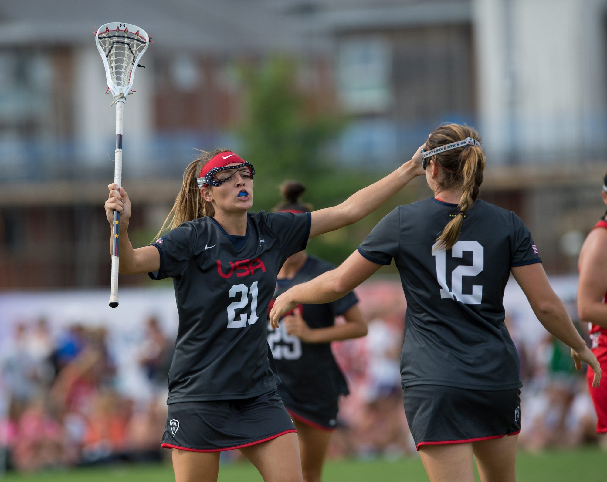 USA's Taylor Cummings celebrates with scorer Kayla Treanor at the 2017 FIL Rathbones Women's Lacrosse World Cup, at Surrey Sports Park, Guildford, Surrey, UK, 18th July 2017.