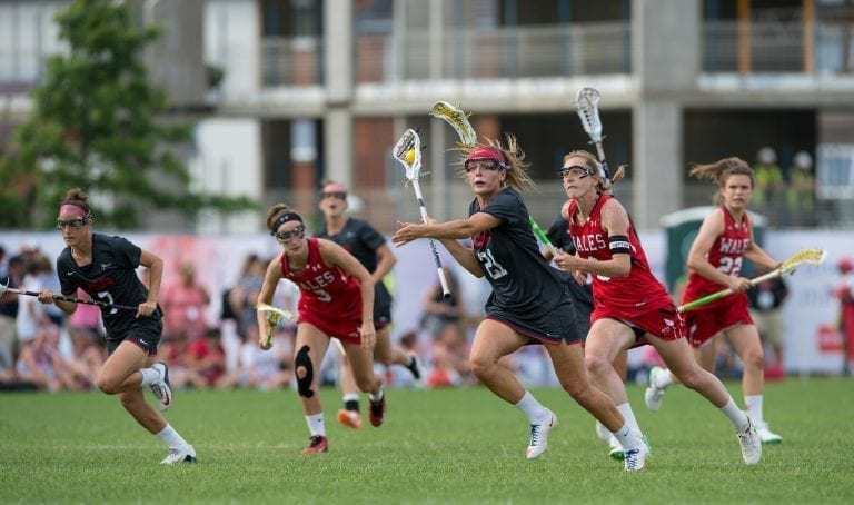 USA's Taylor Cummings breaks out against Wales at the 2017 FIL Rathbones Women's Lacrosse World Cup, at Surrey Sports Park, Guildford, Surrey, UK, 18th July 2017.