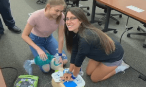 Women's Lacrosse Player Giving CPR